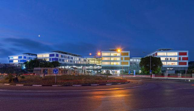 The large building of Curaçao Medical Center at night.