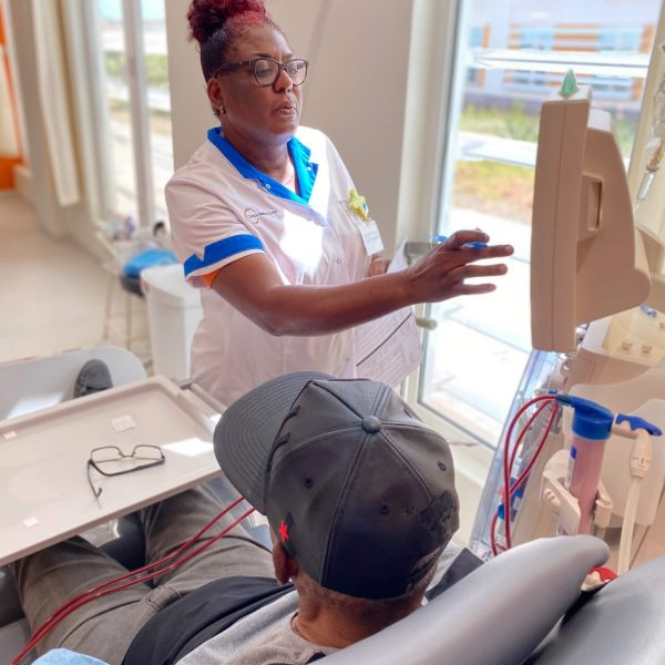 Doctor at the Curaçao Medical Center looking focused while helping patient.